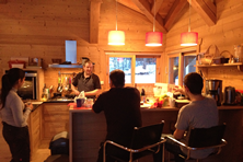 Mark cooking for guests in Chalet Erica